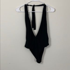 Black backless body suit with low V neck front!